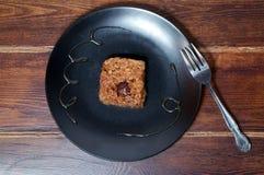 Ossequio dolce del riso coreano con la forcella sul piatto Fotografia Stock Libera da Diritti