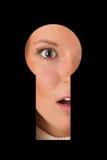 Osservando in buco della serratura GN Fotografia Stock