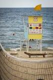 Ossessione per il bagnino nel mare Immagini Stock