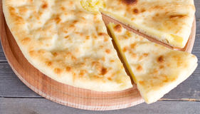 Ossetian pie with cheese and potatoes Stock Photos