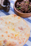 Ossetian pie with cheese and potatoes. Ossetian traditional dish - a pie with cheese and potatoes stock photography