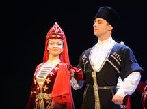 Free Ossetians In Traditional Dress Dancing Folk Mountain Dance. Stock Image - 82913411