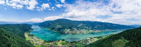 Ossiacher See in Kärnten. Scenic summertime panorama of Lake Ossiach. Ossiacher See in Kaernten. Scenic summertime panorama of Lake Ossiach in Carinthia royalty free stock image