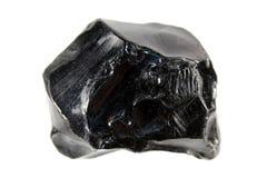 Ossidiana o vetro vulcanico isolato su fondo bianco Fotografie Stock Libere da Diritti