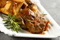 Osso bucco beef. With vegetables and rosemary Stock Photography
