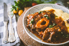 Osso bucco Beef Stew with Polenta. On wooden background Royalty Free Stock Photography