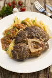 Osso bucco. Tasty osso-bucco served with pasta Stock Images