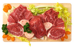 Osso buco of beef. For boiled on wooden board Royalty Free Stock Images