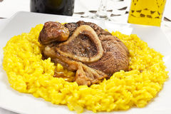 Osso buco bivine meat with rice with saffron Stock Photography