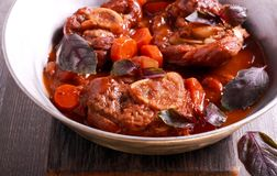 Osso buco braised veal shank with vegetables Stock Image