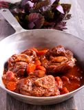Osso buco braised veal shank with vegetables and gravy Royalty Free Stock Photography