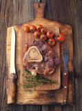 Osso buco roasted with thyme Stock Photos