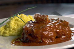 Osso Busc. Osso Buco, eal shanks that are braised in wine with saffron risotto Royalty Free Stock Image