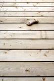 Osso de cão do couro cru no fundo de madeira da placa Fotografia de Stock Royalty Free