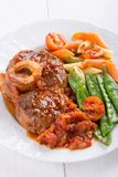Ossobuco. Сross-cut veal shanks braised with vegetables royalty free stock image