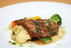 Ossobuco alla milanese, italian cuisine. Ossobuco is a Milanese specialty of cross cut veal shanks braised with vegetables stock photos