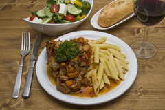 Ossobuco alla milanese. Is a traditional stew from Italy Stock Images