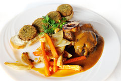 Ossobuco with falafel. Pumpkin on a white background Stock Photos