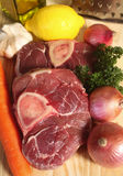 Ossobuco ingredients. Ingredients used in making ossobuco (braised veal shank Royalty Free Stock Photos