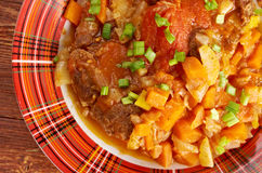 Ossobuco. Italiano country cuisine .Milanese specialty of cross-cut veal shanks braised with vegetables Royalty Free Stock Images