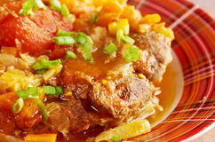 Ossobuco. Italiano country cuisine .Milanese specialty of cross-cut veal shanks braised with vegetables Stock Image