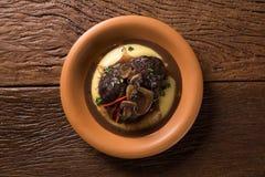 Ossobuco with polenta. Gourmet food Royalty Free Stock Photo