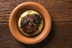 Ossobuco with polenta. Gourmet food Stock Photos