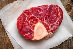 ossobuco, raw cross cut veal shank, Stock Photo