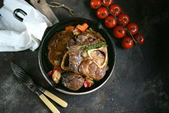 Ossobuko beef with onions, carrots, celery, white wine and thyme. Royalty Free Stock Photos