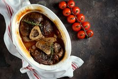 Ossobuko beef with onions, carrots, celery, white wine and thyme. Stock Photos
