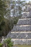 Mayan Ossuary at Chichen Itza. The Ossuary, aka the Bone House or High Priest`s Grave. Its stairs have beautiful snake heads at the base. The square shaft at the Royalty Free Stock Photo