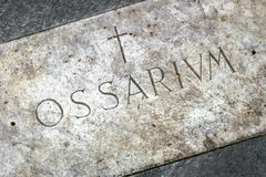 Ossuary cemetery. With the engraving in Latin `Ossarium` translation from Latin Ossario Stock Images