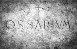 Ossuary cemetery. With the engraving in Latin `Ossarium` translation from Latin Ossario Stock Photos