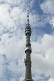 Ostankino teletower. On the background of blue sky and white clouds stock photography
