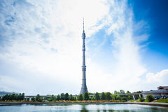 Ostankino tower on blue sky and pond in front Royalty Free Stock Images