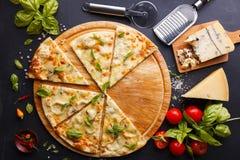 Ostar för pizza fyra Fotografering för Bildbyråer
