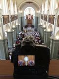 Ostensorial adoration in the catholic church through the camera. Ostensory for worship at a Catholic church ceremony seen through the camera Stock Image