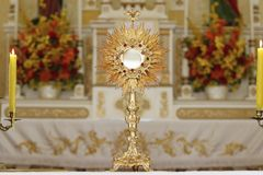 Ostensorial adoration in the catholic church. Ostensory for worship at a Catholic church ceremony Stock Images