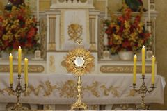 Ostensorial adoration in the catholic church. Ostensory for worship at a Catholic church ceremony Royalty Free Stock Images
