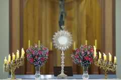 Ostensorial adoration in the catholic church. Ostensory for worship at a Catholic church ceremony Royalty Free Stock Image