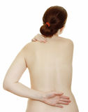 Osteochondrosis in back and neck. Osteochondrosis - woman massaging pain neck and back, isolated over a white background stock images