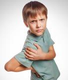 Osteochondrosis kid teenage boy isolatd holds his Stock Photos
