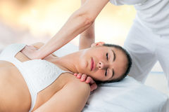 Osteopath applying pressure on female chest. Royalty Free Stock Photo
