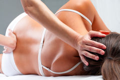 Osteopath Doing Cranial Sacral Exercise On Woman. Stock Images
