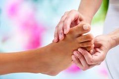 Osteopath doing reflexology massage. Royalty Free Stock Photo