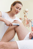 Osteopath Giving Ultrasound Treatment To Male Client With Sports Royalty Free Stock Photo