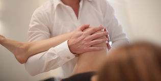 Osteopath manipulating a patient. Legs Royalty Free Stock Photography
