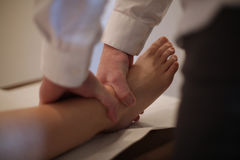 Osteopath manipulating a patient Royalty Free Stock Photo