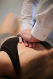 Osteopath manipulating a patient. Legs Stock Photo