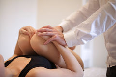 Osteopath manipulating a patient. Legs Royalty Free Stock Photos